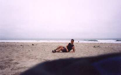 Mile 14: Felix Wong relaxing on the beach.