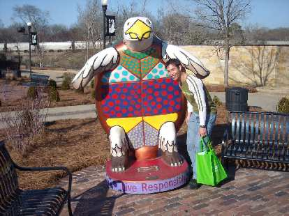 Turtles are Albany's mascot.  Here's one petting a Felix.