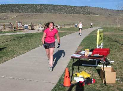 Melanie was closing in fast, by Kelly dug deep and sprinted to hang on for the win!
