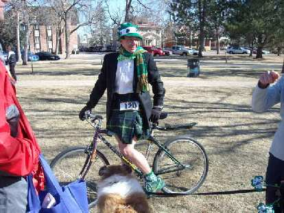 Here is Scott with bike and dog.  Moments later, he disappeared to go ride in the parade!