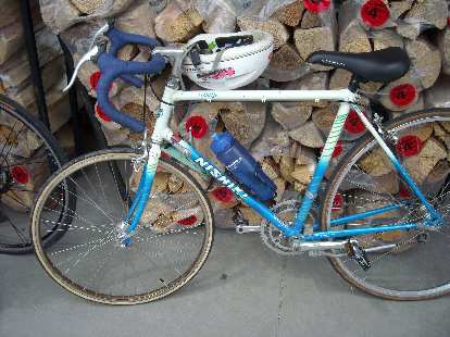 """[Mile 165, 2:34 p.m.] At the Wellington checkpoint I encountered a cyclist who lives really close to me.  He built up this 80s Nishiki for his 7-year-old son using a 24"""" front wheel."""