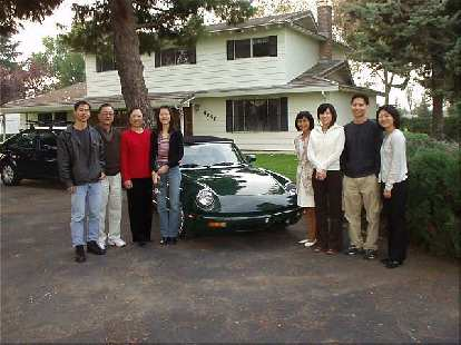 My relatives and I in front of my mom and dad's home of 27 years and my little Alfa.  That's me, Uncle Ronald, Auntie Stella, Cousin Anna, Mom, Sister-in-law Chika, Brother Abiel, and Cousin Cindy.
