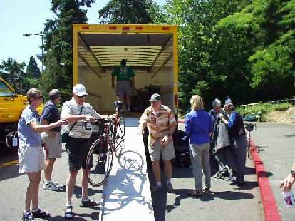 There were moving trucks to take our bikes from downtown Portland to the University of Washington the day before the ride.  People were transported in a tour bus.