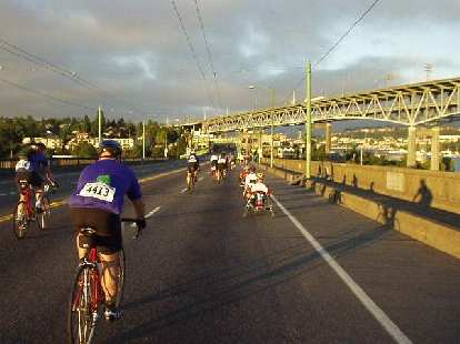 [Day 1, Mile 1.4, 6:04 a.m.] Heading over a bridge in downtown Seattle, in which a lane was closed off for us cyclists.