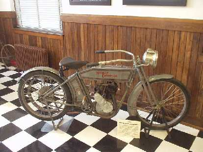 This is a 1913 Harley Davidson.  You can clearly see its bicycle roots.