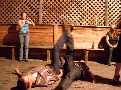 "Jon leg wrestling the ""female state champion"" who was quite drunk."