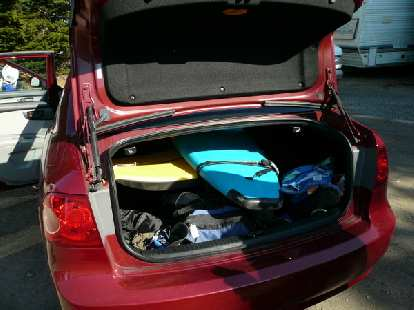 In Watsonville, Adrian and I rented a surfboard.  Amazingly it fit in the Kia Optima rental car.