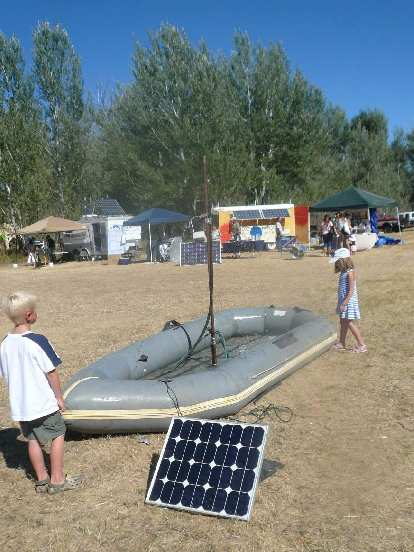 A raft with a solar-powered spigot was popular with the kids, many of whom jumped in.