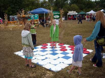 Kids playing a giant game of checkers.