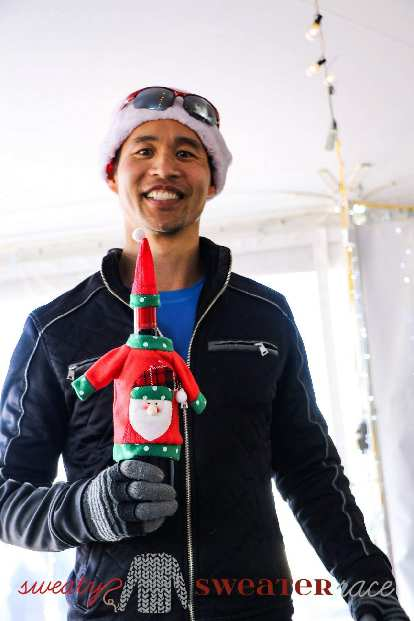 Sweaty Sweater awards were bottles of Robertson South African wines dressed in Christmas outfits. Felix Wong came in third in age group.