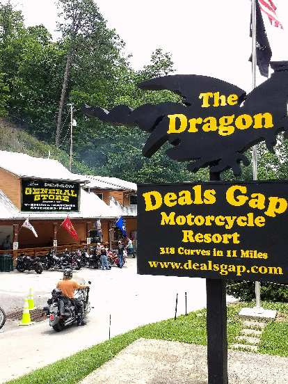 Deals Gap Motorcycle Resort has a sign stating there are 318 curves in 11 miles on the Tail of the Dragon.