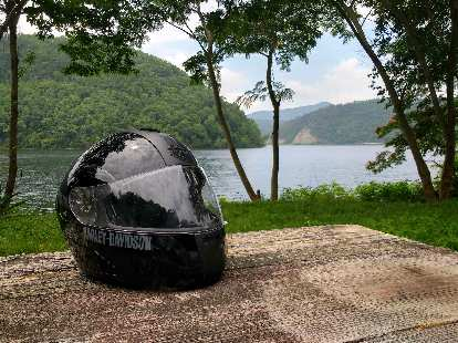 A black Harley-Davidson full-face helmet on a picnic table by Chilhowee Lake in Tennessee.
