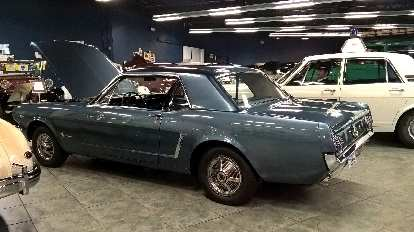 This blue-grey 1965 Ford Mustang and 1968 Ford Zephyr police car to the right of it were converted to all wheel drive by Fergusen Research.