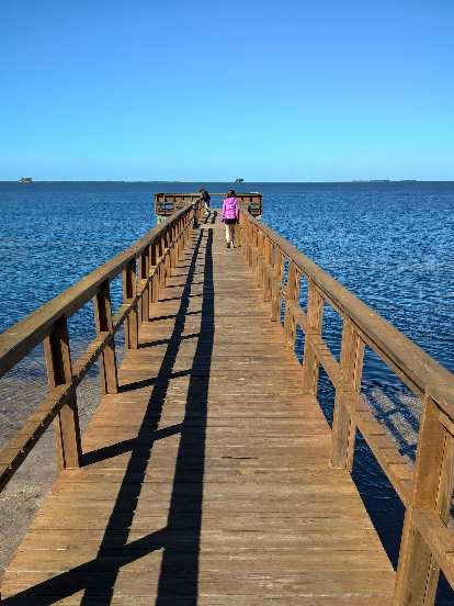 Maureen walking along the Wesley S. Henry Community Pier in Palm Harbor, Florida.