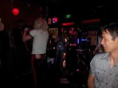 After Friday's Taste of Fort Collins, we met up with Diana and Lauren at the Surfside bar where there was this guy singing Van Halen with exposed butt cheeks.
