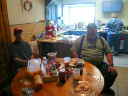 Day 9: In Grant, MT, I stopped by a restaurant that was permanently closed.  Thankfully, the residents nearby -- including Mike (center) and his wife Barbara (right) -- inivited me inside their home for a toast, bacon and egg breakfast.  I also bought some food and water from them.