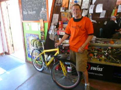 Day 16: At the Orange Peel bike shop, Zach did a great job working on my bike, replacing both tires, rear rim strip, rear tube, brake pads, and cables.  He also cleaned the bike and lubed the chain.