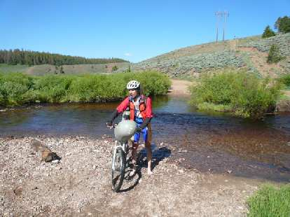 Day 17: At a knee-deep creek crossing, I encountered John Nobile, the eventual winner and record-breaker of the concurrent Great Divide Race.