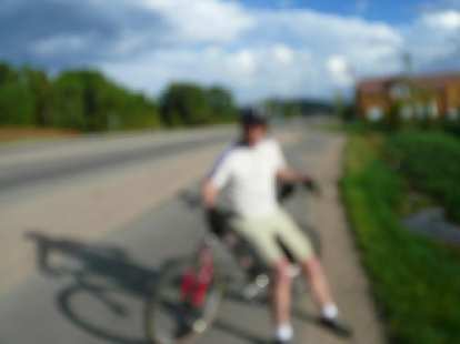 Day 17: In Silverthorne, CO, a local cyclist named Dave met and rode with me.  He was following the Tour Divide online and rode with Leighton White the day before.  (Blurry photo due to camera malfunction.)