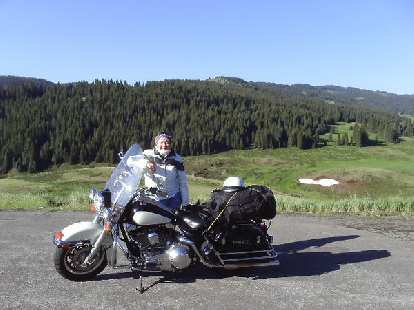 """Day 22: I waited at an intersection very near the New Mexico border for any cyclists to come up, hoping to buy a cyclometer off of them.  No cyclists came, but Patti from Arizona (riding to Alaska) on her """"police bike"""" gave me some Santa Fe trail mix (""""from Wal-mart,"""" she said.)"""