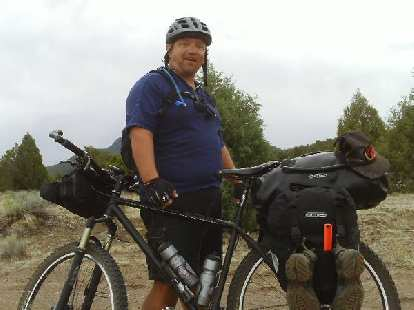 Day 25: Shortly after Pie Town, NM (where there was no pie or food otherwise), I encountered northbound cycle-tourist Tim Saelens.  I was bonking badly and he very generously gave me some pasta, oatmeal, and Heed powder.