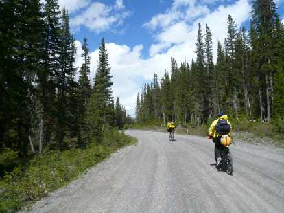 [Day 1, Mile 36] Riding with racer Kevin Hall and, briefly, Andy Buchanan (I think) on a gravel access road near Banff National Park.