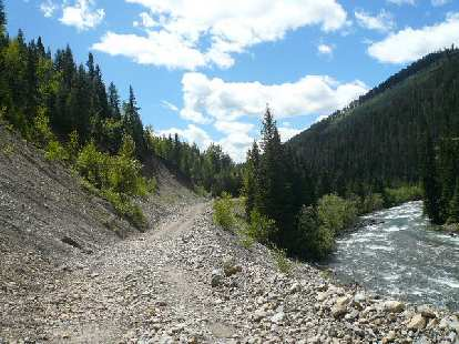 [Day 2, Mile ~120] Rocky trail by a river south of Elkford, BC.