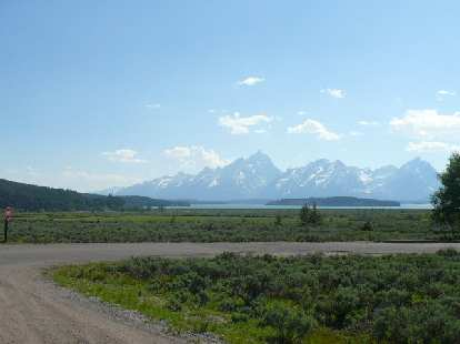 [Day 11, Mile 1020] Jackson Lake, Wyoming with the Grand Tetons in the distance.