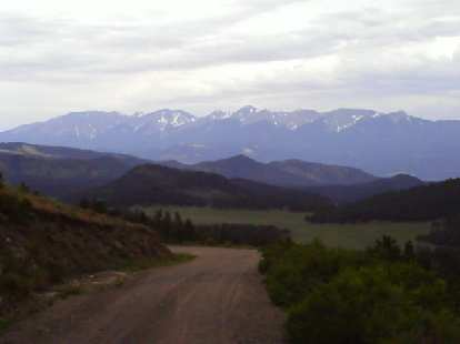 [Day 17, Mile 1767] Descent into Salida, CO with numerous Fourteeners in the distance.
