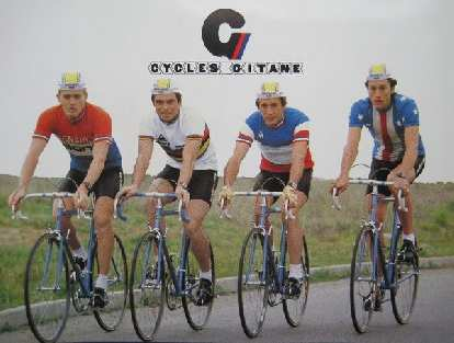 For most of his Tour de France victories, Bernard Hinault (second from the left) rode a Gitane.  This postcard is probably from around 1980.