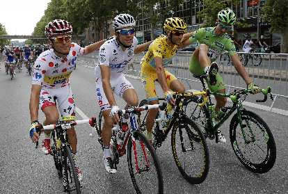 Vincenzo Nibali (in yellow) on a Specialized Tarmac during the final stage of the 2014 Tour de France. Other riders are Rafal Majka (best climber), Thibaut Pinot (best young rider), and Peter Sagan (best sprinter).