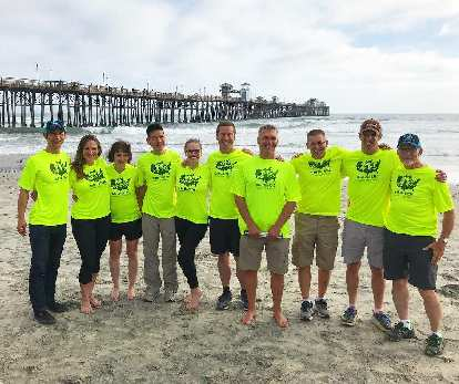 Team Sea to See riders and leadership on the beach in Oceanside, California: Felix Wong, Pamela Ferguson, Tina Ament, Jack Chen, Caroline Gaynor, Charles Scott, Dan Berlin, Chris Howard, Kyle Coon, and Steve O'Leary.