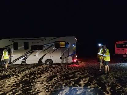 Team Sea to See's big RV that was towing a trailer got stuck in sand in the dessert at night. It took us about 45 minutes to extract it.