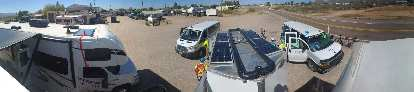 Overhead view of Team Sea to See's RV #2, Command Vehicle, RV #1 (with trailer and solar panels), and one of the two Follow Vehicles.