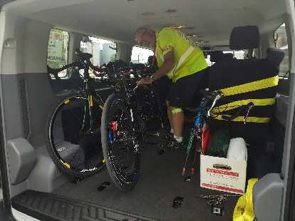 Steve O'Leary (assistant crew chief) securing tandem bicycles inside a van after a bike chain broke on the road.