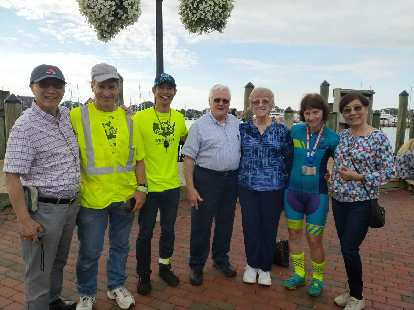 Jack Chen's father, Matt Hannifen, Felix Wong, the two parents of one of the riders, Tina Ament, and another family member or friend in Annapolis after the successful completion of the Race Across America.