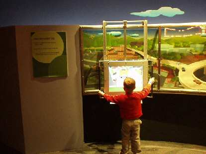 "Here's a boy at the ""Find the Wireless Networks"" exhibit.  The exhibits here are way more fun than at, say, art museums..."