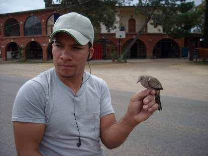 Yoaquin with a bird perched on his fingers.