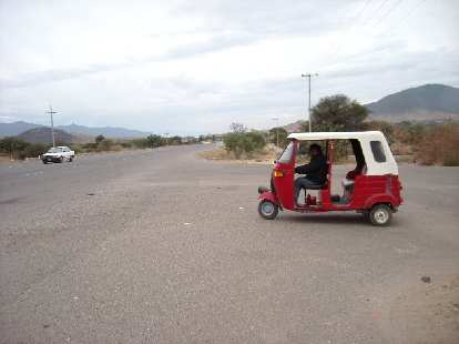 We took a tuk-tuk (three-wheeled taxi) back to the area where we were dropped off the bus earlier in the day.