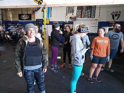 Jennifer and others awaiting the start of Thanksgiving Murph at the Fort Collins Athlete Factory.