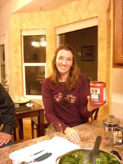 """Tori holding a can of Folger's coffee from my cupboard that apparently expired last year.  She had lots of """"Felix Wong food stories"""" for us."""