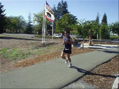 [Mile 23, 3:07 elapsed, 3:37 p.m.] Here's Mike running underneath the stars and stripes and the California flag.