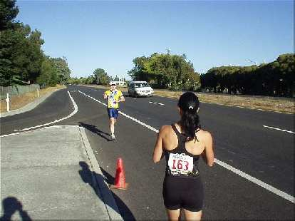 [Mile 149, 20:37 elapsed, 9:07 a.m.] Lisa awaits a handoff from Phil after his third and last leg along Foothill Blvd in Palo Alto.