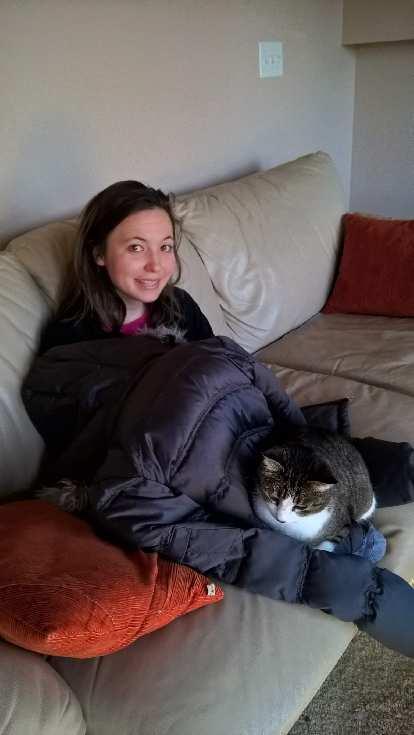 Tiger helping keep Maureen warm.