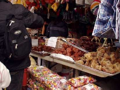 The open air markets kind of reminded me of those in, say, Chongqing, China.  There were flies and bees all over the food.  I cannot imagine anyone wanting to buy or eat that stuff in what seemed to be really unsanitary conditions, but what do I know...