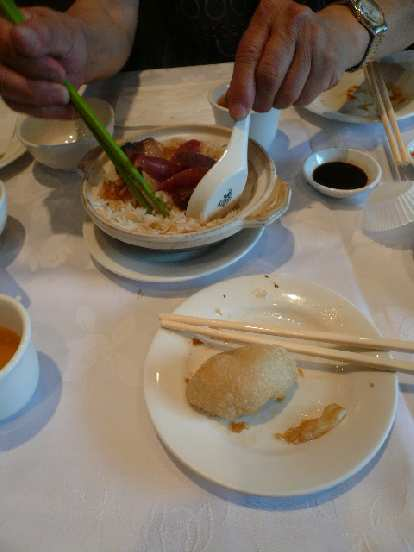 Some of the food we ate included chinese sausage over rice and sesame dumplings.