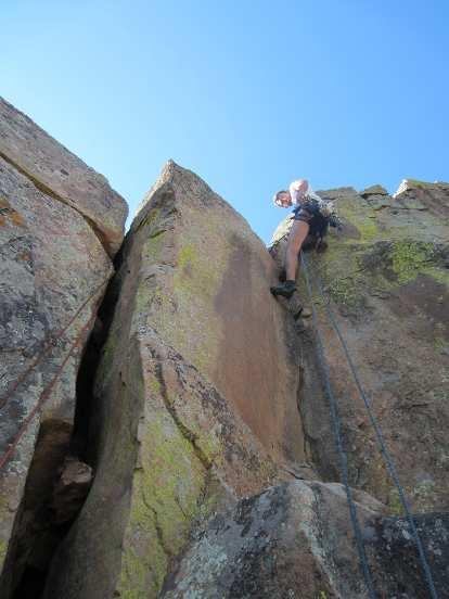 Raphael self-belaying himself up a crack climb.