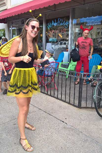 Olivia in a bee costume in front of Walrus Ice Cream.
