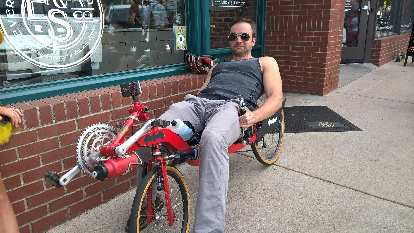 """Chris attempting to take the Reynolds Wishbone """"Batcycle"""" for a spin."""