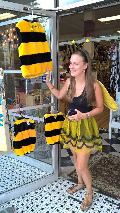 Olivia with other bee costumes at a shop along College Ave.